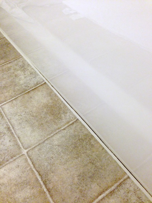 bathtub caulk separation from floor