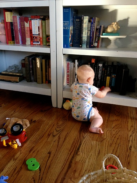 baby and bookshelves