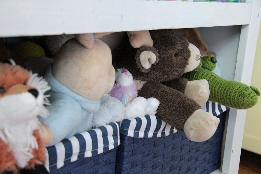 stuffed animals in baskets